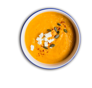 butternut squash soup with cheese and pumpkin seeds