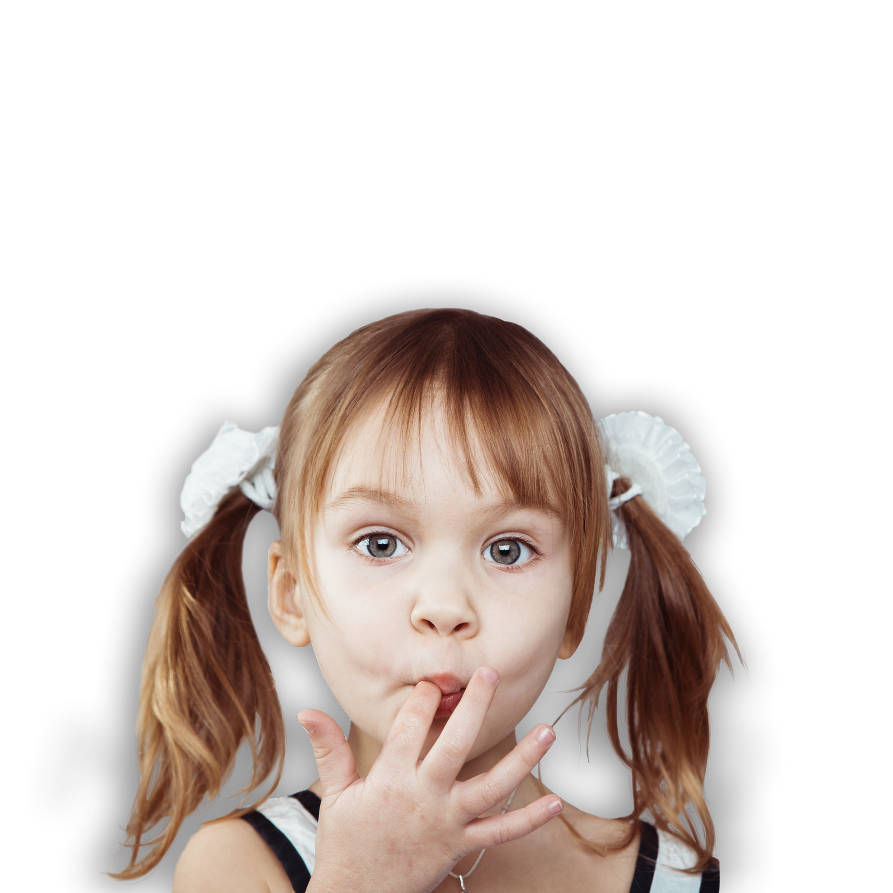 girl with pigtails licking her fingers